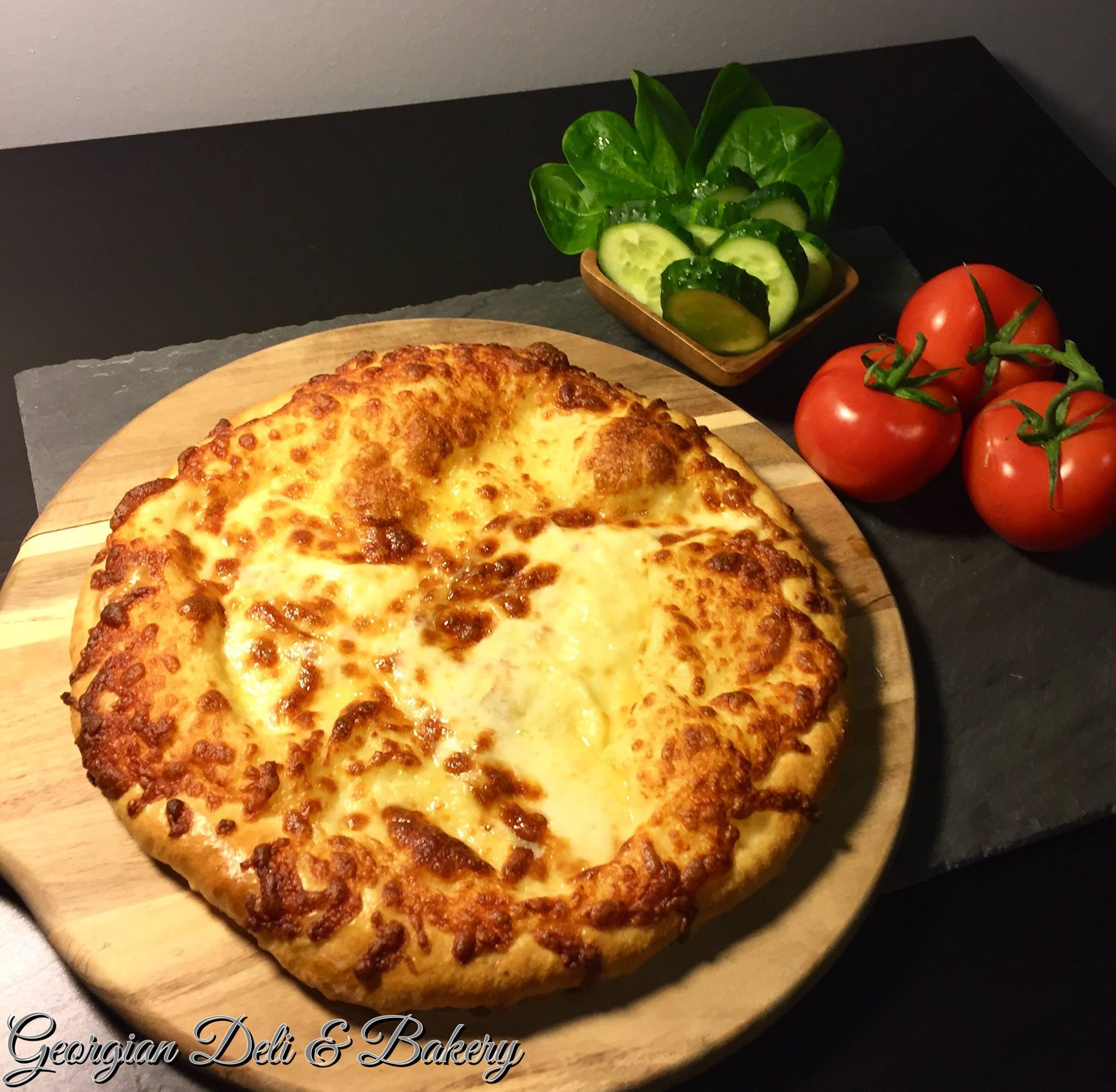 Megruli Khachapuri [Cheese Bread with Extra Cheese on Top